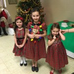 After learning about Wor. Ammon's grandmother's violin, the three sisters were kind enough to stop and pose in their Christmas outfits.